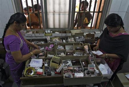 Pharmacists dispense free medication, provided by the government, to patients at Rajiv Gandhi Government General Hospital (RGGGH) in Chennai July 12, 2012. REUTERS/Babu/Files