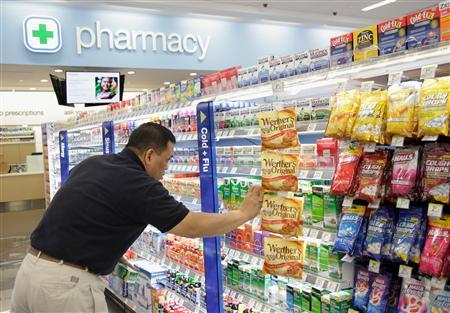 A worker stocks a new Walgreens store in Chicago January 9, 2012. Walgreen Co is going through ''the worst'' part of not being in Express Scripts Inc's network and, while the transition is difficult now, the drugstore should rebound as the year progresses, its top pharmacy executive said on Monday. REUTERS/John Gress (UNITED STATES - Tags: BUSINESS) - RTR2W2PT