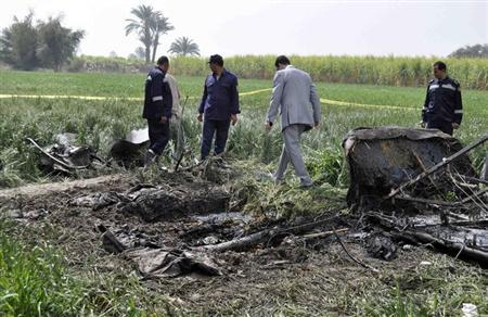 Police and rescue officials check the wreckage of a hot air balloon that crashed in Luxor February 26, 2013. REUTERS/Stringe
