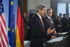 German Foreign Minister Guido Westerwelle (R) and U.S. Secretary of State John Kerry attend a news briefing after talks at the foreign ministry in Berlin February 26, 2013. REUTERS/Thomas Peter