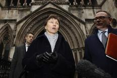 Marina Litvinenko, the wife of former KGB agent Alexander Litvinenko, who was murdered in London in 2006, leaves the High Court in London February 26, 2013. REUTERS/Luke MacGregor