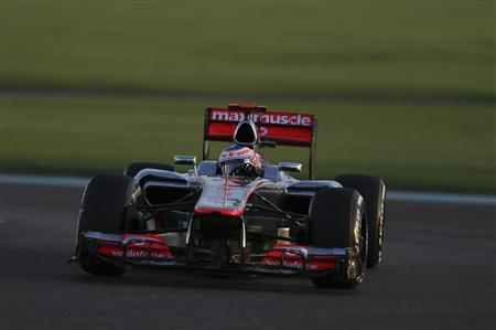 McLaren Formula One driver Jenson Button of Britain drives during the qualifying session of the Abu Dhabi F1 Grand Prix at the Yas Marina circuit on Yas Island November 3, 2012. REUTERS/Ahmed Jadallah