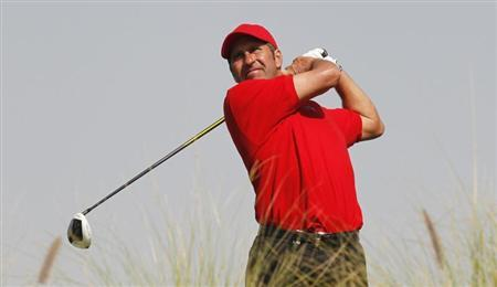 Jose Maria Olazabal of Spain watches the ball during the second round of the Commercial Bank Qatar Masters at the Doha Golf Club January 24, 2013. REUTERS/Mohammed Dabbous