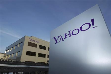 A Yahoo logo is pictured in front of a building in Rolle, 30 km (19 miles) east of Geneva, December12, 2012. REUTERS/Denis Balibouse/Files