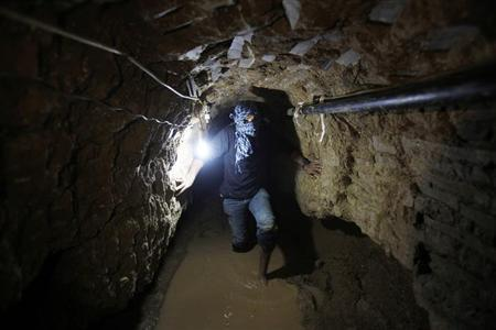 A Palestinian works inside a smuggling tunnel flooded by Egyptian forces, beneath the Egyptian-Gaza border in Rafah, in the southern Gaza Strip February 19, 2013. REUTERS/Ibraheem Abu Mustafa