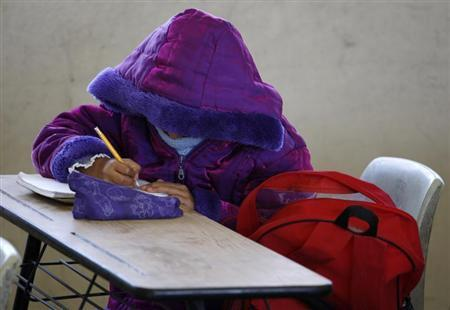 A school girl wears a thick anorak to protect against low temperatures while attending class in Ciudad Juarez January 7, 2013. REUTERS/Jose Luis Gonzalez