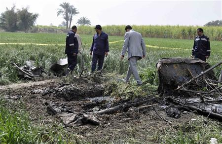 Police and rescue officials check the wreckage of a hot air balloon that crashed in Luxor February 26, 2013. REUTERS/Stringer