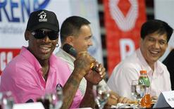 Former NBA Chicago Bulls player Dennis Rodman (L) shares a light moment during a news conference inside a mall of Asia Arena in Manila July 17, 2012. REUTERS/Romeo Ranoco