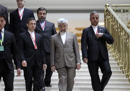 Iran's Supreme National Security Council Secretary and chief nuclear negotiator Saeed Jalili (2nd R, front) walks down the stairs before talks in Almaty February 26, 2013. REUTERS/Stanislav Filippov/Pool
