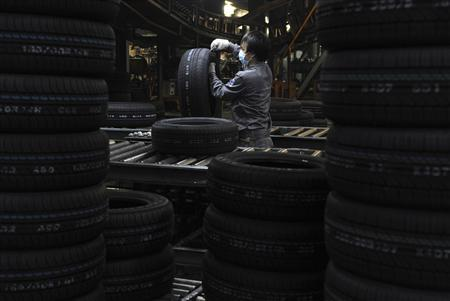 An employee checks tyres at a Hankook Tire factory in Jiaxing, Zhejiang province in this December 6, 2011 file photo. REUTERS/Stringer/Files