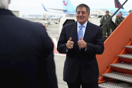U.S. Secretary of Defense Leon Panetta gives a thumbs-up to U.S. Ambassador to the North Atlantic Treaty Organization Ivo Daalder before boarding his aircraft and departing in Brussels, Belgium February 22, 2013. REUTERS/Chip Somodevilla/Pool