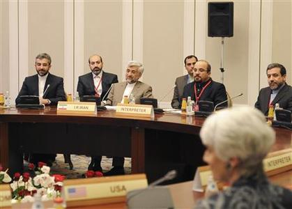 Members of the Iranian delegation, led by Supreme National Security Council Secretary and chief nuclear negotiator Saeed Jalili (3rd L), sit at a table during talks in Almaty February 26, 2013. World powers began talks with Iran on its nuclear programme in the Kazakh city of Almaty on Tuesday, in a fresh attempt to resolve a decade-old standoff that threatens the Middle East with a new war. REUTERS/Ilyas Omarov/Pool