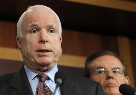 Senator John McCain (R-AZ) (L) speaks while Senator Robert Menendez (D-NJ) listens during a news conference on comprehensive immigration reform at the U.S. Capitol in Washington January 28, 2013. REUTERS/Gary Cameron