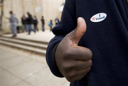 A voter gives a thumb's up after voting at the Martin Luther King Jr. Elementary School in the Anacostia neighborhood of Washington, in this file photo taken November 4, 2008. REUTERS/Larry Downing