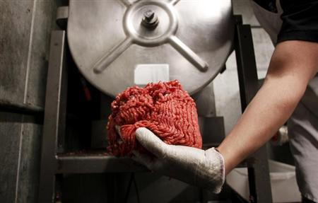 Butcher Brett Marley holds the freshly ground beef at Casey's Market in Western Springs, Illinois, April 25, 2012. REUTERS/Jeff Haynes