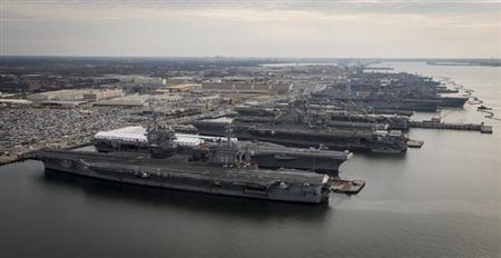 Aircraft carriers USS Dwight D. Eisenhower (CVN 69), USS George H.W. Bush (CVN 77), USS Enterprise (CVN 65), USS Harry S. Truman (CVN 75), and USS Abraham Lincoln (CVN 72) are in port at Naval Station Norfolk, Virginia, in this December 20, 2012 handout photo courtesy of the U.S. Navy. REUTERS/U.S. Navy/Chief Mass Communication Specialist Ryan J. Courtade/Handout/Files