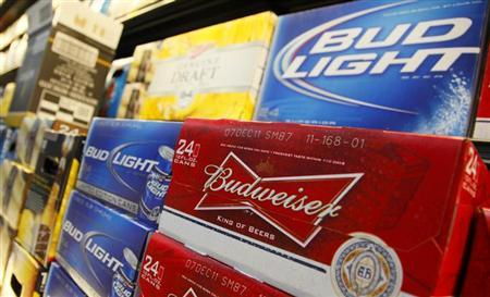 Anheuser Busch's Budweiser and Bud Light Beer can be seen on display at a new Wal-Mart store in Chicago, January 24, 2012. REUTERS/John Gress/Files