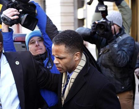 Former U.S. Rep. Jesse Jackson Jr. (C) departs the U.S. District Federal Courthouse in Washington February 20, 2013. REUTERS/Gary Cameron