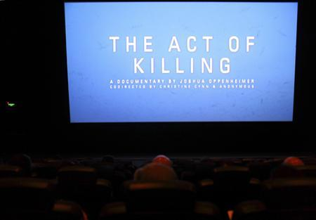 The opening of ''The Act of Killing'', a documentary made by Texan-born director Joshua Oppenheimer, is pictured during an underground screening at a theatre in Jakarta February 6, 2013. REUTERS/Beawiharta