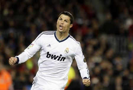 Real Madrid's Cristiano Ronaldo celebrates after scoring a penalty against Barcelona during their Spanish King's Cup semifinal second round soccer match at Camp Nou stadium in Barcelona February 26, 2013. REUTERS/Gustau Nacarino
