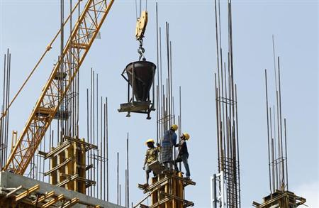 Labourers work at the construction site of a commercial complex in Chennai February 21, 2013. REUTERS/Babu