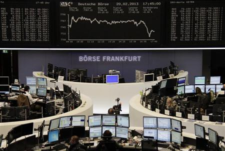 A cameraman films in front of the DAX board at the Frankfurt stock exchange February 20, 2013. REUTERS/Remote/Janine Eggert