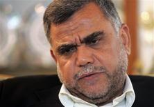 Hadi al-Amiri, an Iraqi member of parliament and head of a Shi'ite militia, speaks during an interview with Reuters in Baghdad in this February 17, 2006 file photo. REUTERS/Ali Jasim/Files