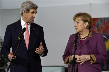 U.S. Secretary of State John Kerry speaks next to German Chancellor Angela Merkel during a news conference at the Chancellery in Berlin, February 26, 2013. REUTERS/Jacquelyn Martin/Pool (GERMANY - Tags: POLITICS) - RTR3EB45