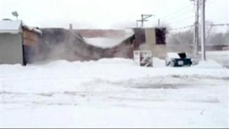 Video screenshot of blizzard conditions in the U.S. Plains which shut down highways on Tuesday and forced hundreds of flight cancellations. REUTERS/TV