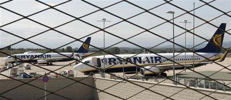 Ryanair planes are seen parked through a fence at Girona airport, September 20, 2012. REUTERS/Albert Gea