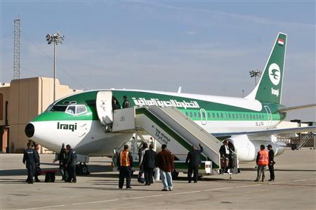 Passengers disembark from the first post-Saddam era commercial flight between Baghdad and the southern Iraq port city of Basra on January 1, 2005. REUTERS/Atef Hassan