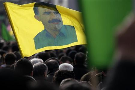 Demonstrators hold a flag with a portrait of jailed Kurdistan Workers Party (PKK) leader Abdullah Ocalan during a protest in Strasbourg February 18, 2012. REUTERS/Vincent Kessler