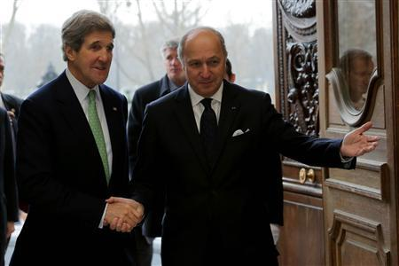 French Foreign Affairs minister Laurent Fabius (R) welcomes U.S. Secretary of State John Kerry at the Quai d'Orsay Ministry in Paris February 27, 2013. REUTERS/Philippe Wojazer