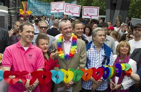 Berlin Mayor Klaus Wowereit (first row 2nd R), U.S. Ambassador to Germany Philip Murphy (first row 3rd R), Britain's ambassador to Germany Simon McDonald (first row L) and the Green Party parliamentary faction co-leader Renate Kuenast (first row 2nd L) open the Christopher Street Day (CSD) parade in Berlin, June 23, 2012. The annual street parade parade is a celebration of lesbian, gay, bisexual, and transgender lifestyles and denounces discrimination and exclusion. REUTERS/Thomas Peter