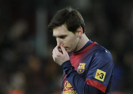 Barcelona's Lionel Messi reacts as he leaves the pitch after their Spanish King's Cup semifinal second round soccer match against Real Madrid at Camp Nou stadium in Barcelona February 26, 2013. REUTERS/Albert Gea