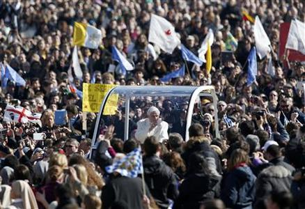 Pope Benedict XVI waves to the faithful as he arrives in St Peter's Square to hold his last general audience at the Vatican February 27, 2013. The weekly event which would normally be held in a vast auditorium in winter, but has been moved outdoors to St. Peter's Square so more people can attend. The pope has two days left before he takes the historic step of becoming the first pontiff in some six centuries to step down instead of ruling for life. REUTERS/Alessandro Bianchi