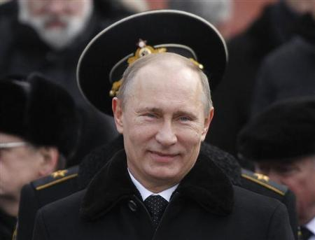 Russian President Vladimir Putin attends a wreath laying ceremony to mark the Defender of the Fatherland Day in Moscow February 23, 2013. REUTERS/Maxim Shemetov