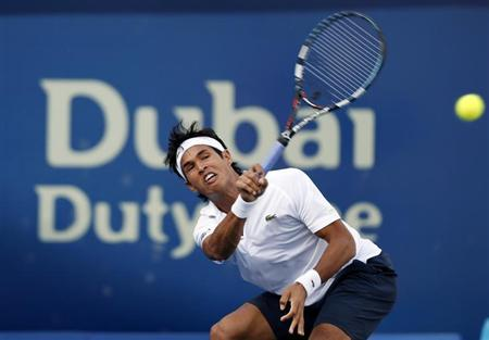 Somdev Devvarman hits a return to Juan Martin Del Potro of Argentina during their men's singles match at the ATP Dubai Tennis Championships, February 27, 2013. REUTERS/Mohammed Salem