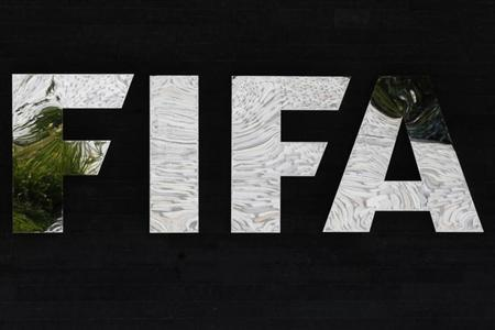 A logo of the International Federation of Football Association (FIFA) is pictured at the Home of FIFA in Zurich July 5, 2012. REUTERS/Michael Buholzer/Files