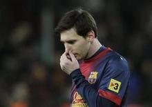 Lionel Messi, buteur dans deux finales européennes, a rarement été accusé de ne pas être décisif lors de matches importants, mais la question se pose après les défaites de Barcelone face au Milan AC, en huitième aller de Ligue des Champions et au Real Madrid, en demi-finale de la Coupe du Roi. /Photo prise le 26 février 2013/REUTERS/Albert Gea