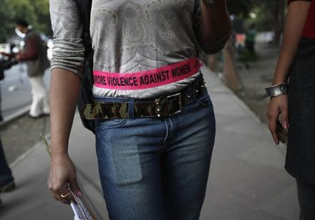A woman stands on a pavement as she participates in the ''One Billion Rising'' campaign in New Delhi February 14, 2013. REUTERS/Mansi Thapliyal