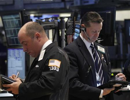 Traders work on the floor of the New York Stock Exchange, February 13, 2013. REUTERS/Brendan McDermid