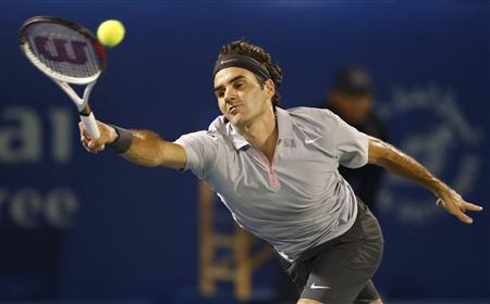 Roger Federer of Switzerland hits a return to Spain's Marcel Granollers during their men's singles match at the ATP Dubai Tennis Championships, February 27, 2013. REUTERS/Mohammed Salem