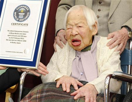 Misao Okawa (R) receives a certification from an official of Guinness World Records in Osaka, western Japan, in this photo taken by Kyodo February 27, 2013. Okawa of the western Japanese city of Osaka was on Wednesday officially recognised by the Guinness World Records as the oldest woman alive at 114 years old. Born to a clothing merchant in 1898, also the year of the Spanish-American war, Okawa is due to celebrate her 115th birthday next week on March 5th. Mandatory Credit. REUTERS/Kyodo