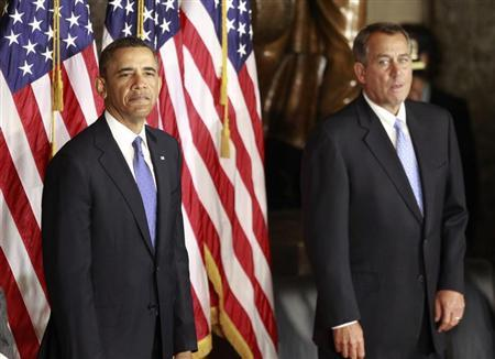 U.S. President Barack Obama stands alongside House Speaker John Boehner (R-OH) as they participate in the unveiling of a statue in honor of civil rights activist Rosa Parks, in Statuary Hall in the U.S. Capitol in Washington, February 27, 2013. The statue of Rosa Parks, who served as a catalyst for the U.S. civil rights movement by refusing to give up her seat to a white passenger on an Alabama bus in 1955, is the first full length statue for an African American woman to feature on Capitol Hill. REUTERS/Jason Reed (UNITED STATES - Tags: POLITICS BUSINESS) - RTR3ECVO