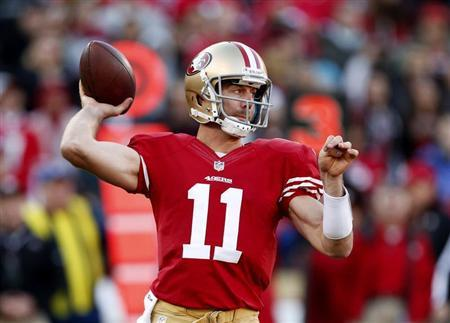 San Francisco 49ers quarterback Alex Smith throws the ball during the fourth quarter of their NFL football game against the Arizona Cardinals in San Francisco, California in this file photo taken December 30, 2012. REUTERS/Beck Diefenbach