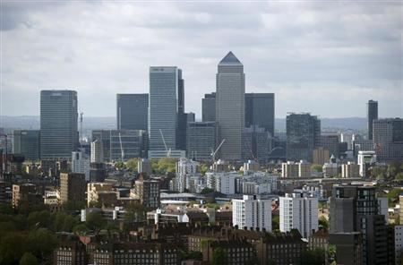 The Canary Wharf financial district is seen from the top of the ArcelorMittal Orbit in the London 2012 Olympic Park in east London May 11, 2012. The structure was officially unveiled on Friday. REUTERS/Ki Price