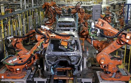 Auto assembly line robots weld on the frame of 2009 Dodge Ram pick-up trucks at the Warren Truck Assembly Plant in Warren, Michigan September 12, 2008. REUTERS/Rebecca Cook