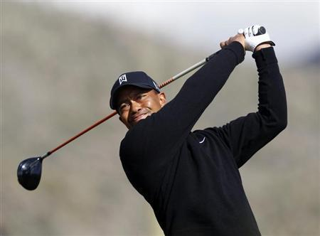 Tiger Woods of the U.S. hits off the second tee against his compatriot Charles Howell III during the weather delayed first round of the WGC-Accenture Match Play Championship golf tournament in Marana, Arizona in this file photo taken February 21, 2013. REUTERS/Matt Sullivan