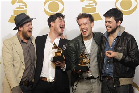 Mumford & Sons pose with their awards for Album of the Year for ''Babel'' and Best Long Form Music Video for ''Big Easy Express'' backstage at the 55th annual Grammy Awards in Los Angeles, California February 10, 2013. REUTERS/Mario Anzuoni